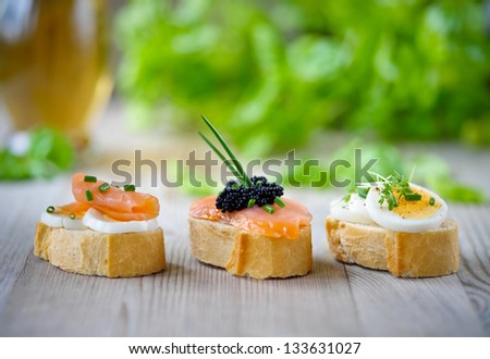 french baguette with salmon, caviar and eggs