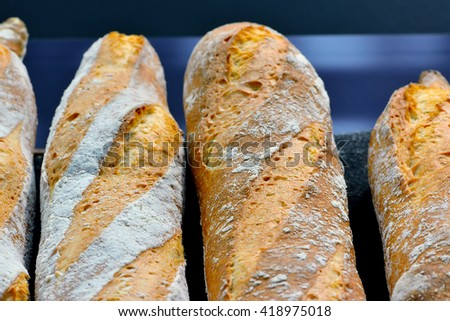 French bread baguettes on a dark blue background. Macro shooting - stock photo