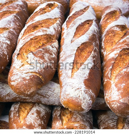 French breads in a bakery market  - stock photo