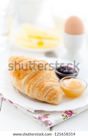 French breakfast with croissant, cheese, egg and jam - stock photo