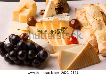 french cheese platter with grapes for drink wine