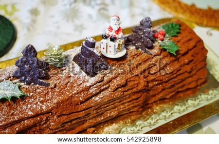french chocolate yule log cake buche de noel with christmas decorations - Decoration Buche De Noel