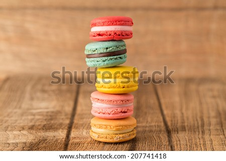 french colorful macarons on a wooden floor - stock photo