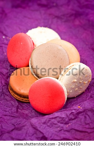 French colorful macarons on violet background - stock photo