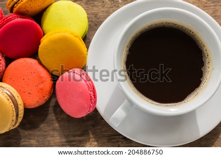 French colorful macarons with cup of coffee - stock photo