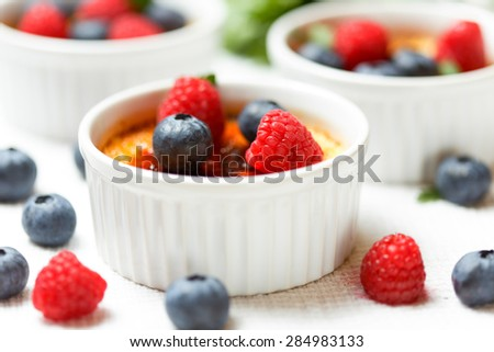 French creme brulee with fresh berries and mint leaves