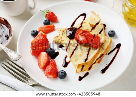 french crepe with berries, food close-up - stock photo