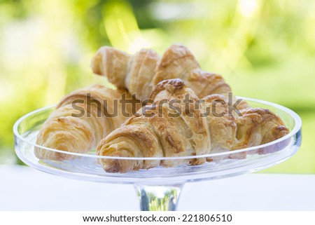 French Croissants on glass dish - stock photo