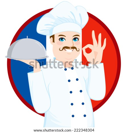 French cuisine chef with funny big mustache holding silver tray gesturing ok sign in front of French flag - stock photo