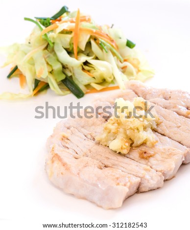 french cuisine, fried pork chop served with garlic and fried vegetable