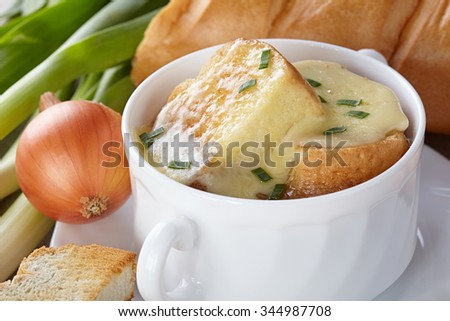 French cuisine. Onion soup served in a white tureen - stock photo