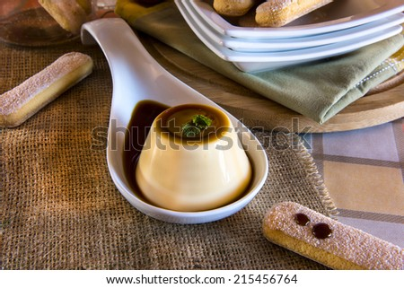 "French dessert called ""Creme caramel"" with italian biscuits called ""savoiardi"" - stock photo"