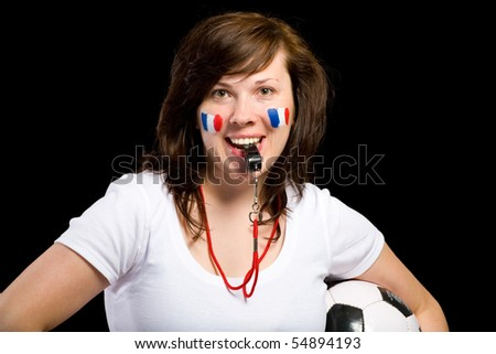 french female football supporter with whistle and football ball, studio shoot isolated on black background