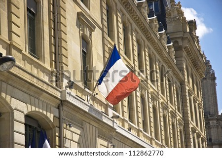French flag hanging from a base of a window - stock photo