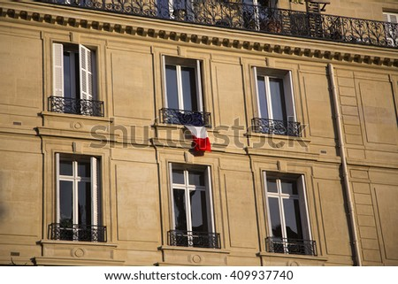 French flag on window of building in Paris, France