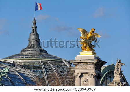 French flag over the Grand Palais, Paris, France.