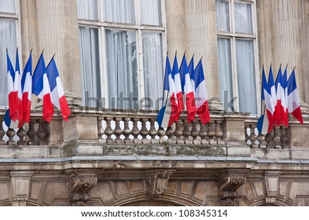 French flags decorate a local government building in Lille, France - stock photo