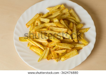 french fried potatoes on plate