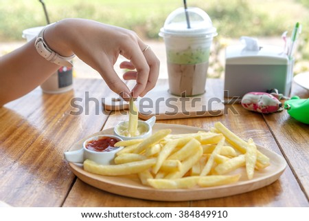 french fried with cheese dip,French fries with cheese sauce - stock photo