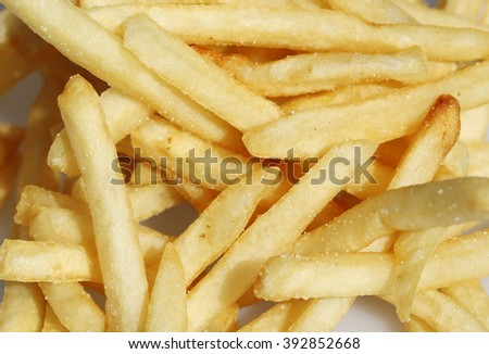 French fries - aka FREEDOM FRIES in America, made from Deep Frying potato Strips in Hot Oil. A fast food staple around the world.  Close up shot taken with a 100mm Macro Lens. - stock photo