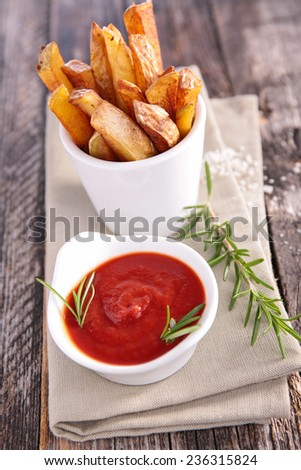 french fries and ketchup - stock photo
