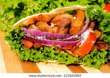 French fries and meat in tortilla
