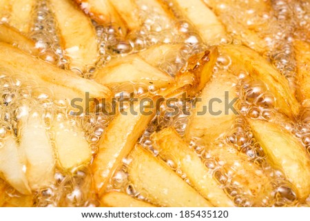 French Fries Boiling In Hot Oil - stock photo