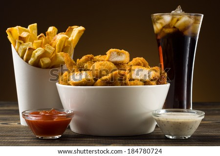 French fries chicken nuggets - stock photo