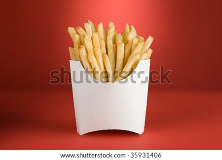 french fries in a white box on a red background - stock photo
