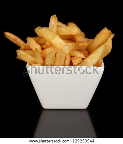 French fries in bowl isolated on black - stock photo