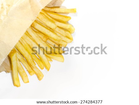 French fries in brown paper bag on white background