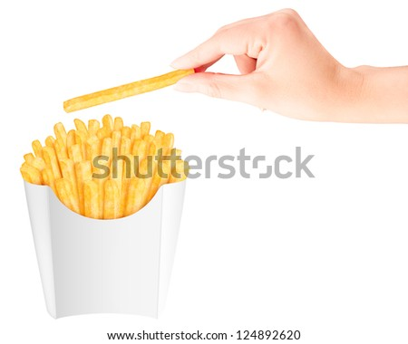 French fries in packaging with hand holding one above - stock photo