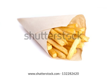 french fries in paper container over white background - stock photo