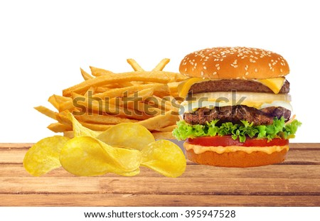 French fries in white box and cheeseburger on table isolated on white