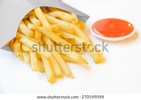 french fries in white box with chili sauce