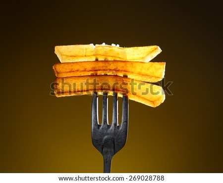 French fries on a fork