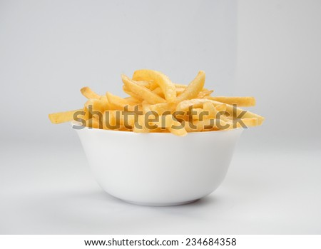 french fries on a plate close up