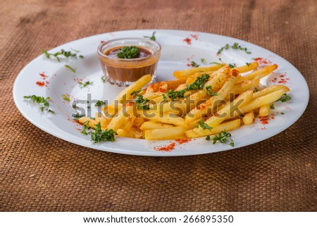 French fries on a plate with different spices. French fries with ketchup. fast food - stock photo