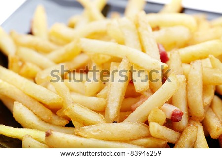 French fries on black dish