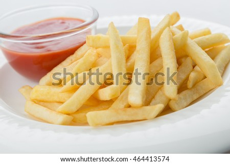 french fries on white dish with ketchup