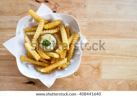 French fries on wooden table. Top view - stock photo