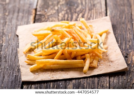 French fries potatoes on wooden table