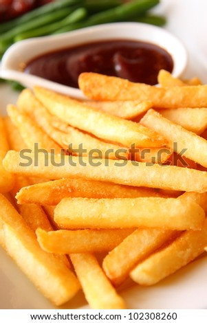 French Fries with Barbecue dipping - stock photo