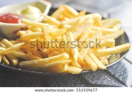 French fries with ketchup and mayonnaise dish