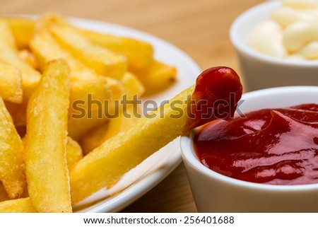 French fries with ketchup and mayonnaise sauces - stock photo
