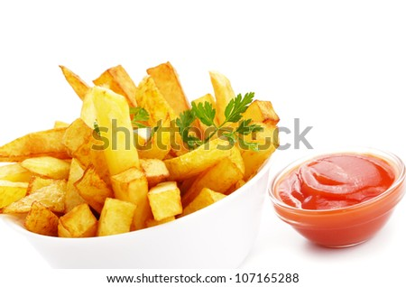 French fries with ketchup closeup over white background