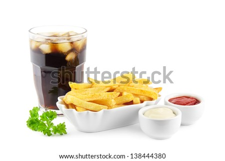 French fries with ketchup, mayonnaise and a soda with ice cubes - stock photo