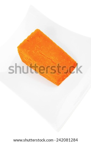 french gourmet dark cheddar cheese served on a ceramic plate isolated over white background - stock photo