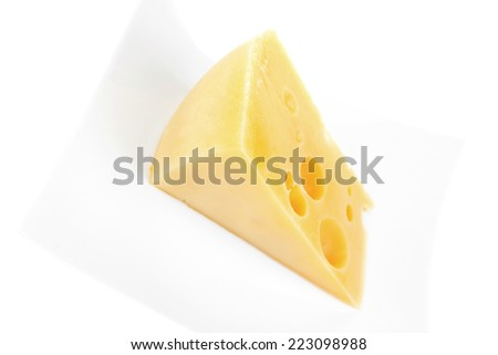 french gourmet parmesan cheese  on china plate isolated over white background