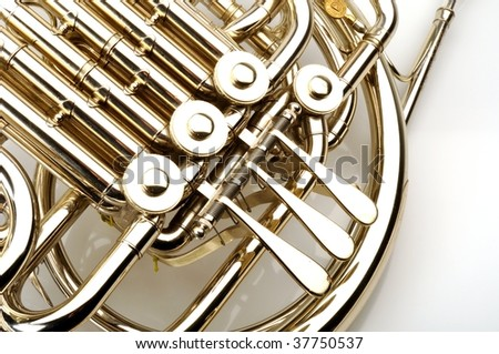 French horn detail on white background